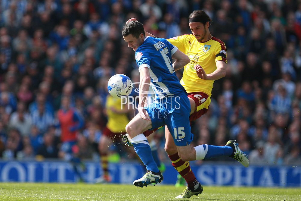 Brighton player Jamie Murphy gets the better of Burnley midfielder George Boyd during the Sky Bet Championship match between Brighton and Hove Albion and Burnley at the American Express Community Stadium, Brighton and Hove, England on 2 April 2016. Photo by Bennett Dean.