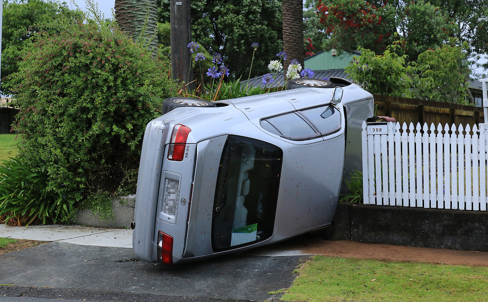 The sole occupant of a car was trapped after it rolled on Great North Road, Auckland, New Zealand, Friday, December 25, 2015. Credit:SNPA / Hayden Woodward