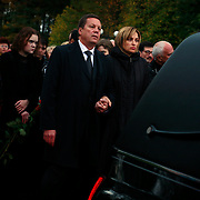 The daughter of Russian journalist Anna Politkovskaya, Vera, attends her funeral. Politkovskaya was murdered in Moscow on 7 October, 2006. She was shot four times, once in the head, in an elevator in her apartment block. .The funeral, held in the Troyekurovskoye cemetery in western Moscow, was conducted by an Orthodox priest. Before the burial, thousands of well-wishers filed passed her body..Known for her critical coverage of the war in Chechnya and of Russian President Vladimir Putin, her murder is widely believed to be connected to her investigative work..The 48-year-old was a tireless reporter who had written a critical book on Russian President Vladimir Putin and his campaign in Chechnya, documenting widespread abuse of civilians by government troops..She leaves behind a son, a daughter and an ex-husband.