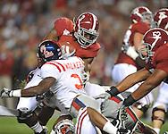 Alabama running back Trent Richardson (3) is tackled  y Ole Miss linebacker Allen Walker (9) at Bryant-Denny Stadium in Tuscaloosa, Ala.  on Saturday, October 16, 2010. Alabama won 23-10.