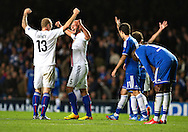 Basel's Ivan Ivanov (left) and Arlind Ajeti celebrate after winning against Chelsea, during their UEFA Champions League group match at Stamford Bridge in London, 27 August 2013.  BOGDAN MARAN / BPA