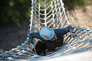 Pamela Gaboury climbs up the ziplining tower at the Challenge Course at The Ridges. Photo by Hannah Ruhoff