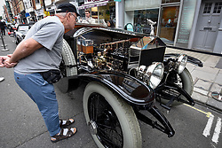 © Licensed to London News Pictures. 17/06/2018. LONDON, UK. A visitor view the engine of a 1914 Rolls Royce Silver Ghost at the 6th Annual Classic and Supercar Pageant held at St John's Wood High Street.  Traditionally taking place on Fathers' Day, the show brings together an eclectic mix of exotic and popular vehicles attracting visitors young and old and raises funds for the local charity, The St John's Hospice.  Photo credit: Stephen Chung/LNP