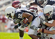 Sept 19, 2009; State College, PA, USA; Penn State running back Evan Royster (22) is tackled by several Temple defenders during the first half at Beaver Stadium.  Mandatory Credit: Jason Miller-US PRESSWIRE