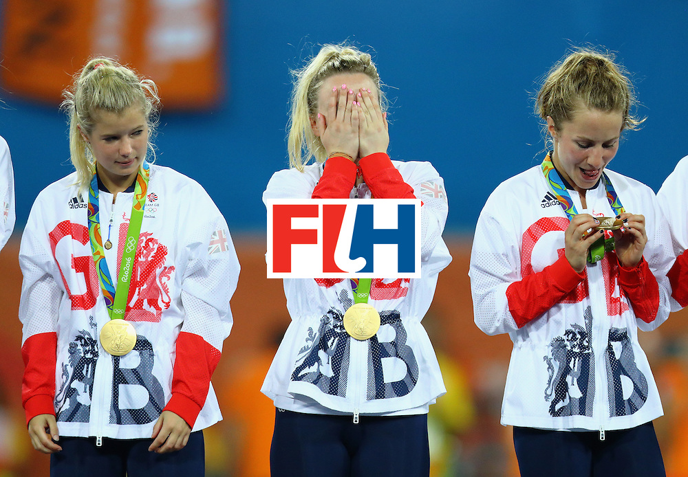 RIO DE JANEIRO, BRAZIL - AUGUST 19:  Hollie Webb #20 of Great Britain (C) reacts on the podium after defeating Netherlands in the Women's Gold Medal Match on Day 14 of the Rio 2016 Olympic Games at the Olympic Hockey Centre on August 19, 2016 in Rio de Janeiro, Brazil.  (Photo by Tom Pennington/Getty Images)