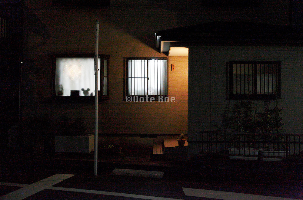 from inside lighted up window of a modern residential house Japan