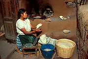 MEXICO, PEOPLE, VILLAGES Making tortillas on Janitzio Island in Lake Patzcuaro, Michoacan