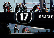 Oracle Team USA skipper Jimmy Spithill (top left) leads his crew during practice before race 16 of the America's Cup Finals on Monday, September 23, 2013 in San Francisco, Calif.