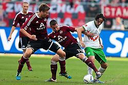17.09.2011, easy Credit Stadion, Nuernberg, GER, 1.FBL, 1. FC Nürnberg / Nuernberg vs SV Werder Bremen, im Bild:.Jens Hegeler (Nuernberg #13) und Robert Mak (Nuernberg #14) gg Claudio Pizarro (Bremen #24).// during the Match GER, 1.FBL, 1. FC Nürnberg / Nuernberg vs SV Werder Bremen on 2011/09/17, easy Credit Stadion, Nuernberg, Germany..EXPA Pictures © 2011, PhotoCredit: EXPA/ nph/  Will       ****** out of GER / CRO  / BEL ******