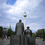 The bronze statues of Marx and Engels seem to sadly observe  the Fernsenturm, one of the symbols of Berlin.