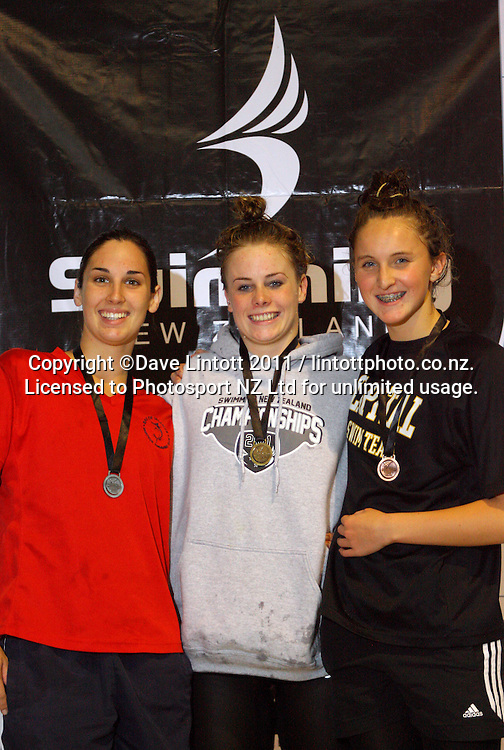 16yo Girls 200m butterfly podium, from left, Ashlee crane (2), Josie Kydd (1) and Ali Clareburt (3). New Zealand Age Group Swimming Championships day five at Welllington Aquatics Centre, Kilbirnie, Wellington, New Zealand on Saturday, 5 March 2011. Photo: Dave Lintott / photosport.co.nz