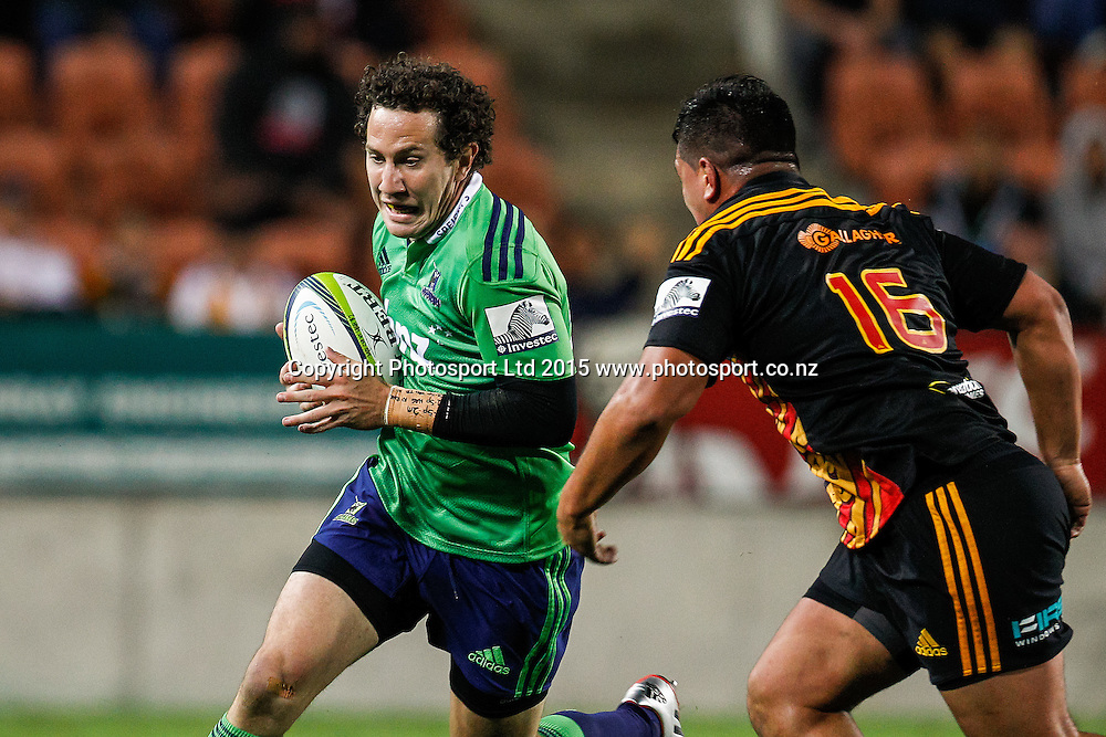 Highlander's Marty Banks looks to beat Chief's Quentin MacDonald during the Super 15 Rugby Match - Chiefs v Highlanders, 6 March 2015 at Waikato Stadium, Hamilton, New Zealand on Friday 6 March 2015.  Photo:  Bruce Lim / www.photosport.co.nz