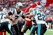 Carolina Panthers Quarterback Kyle Allen (7) hands off to Carolina Panthers Running Back Christian McCaffrey (22) during the International Series match between Tampa Bay Buccaneers and Carolina Panthers at Tottenham Hotspur Stadium, London, United Kingdom on 13 October 2019.