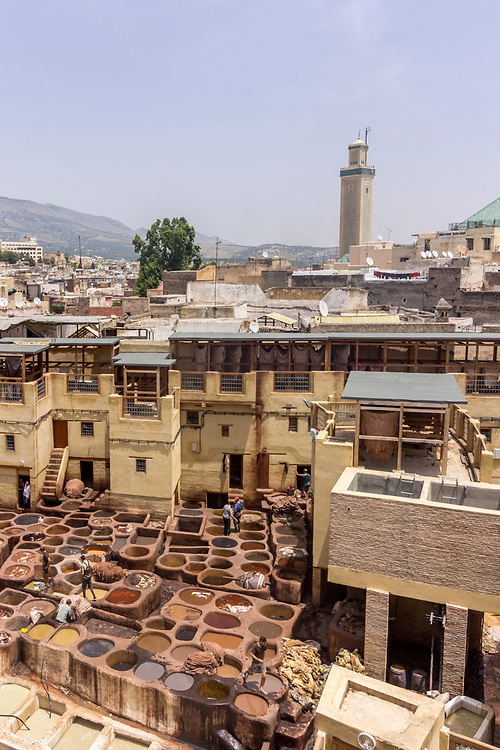 Fes el Bali city skyline and terrace view of the dye pots at leather traditional tanneries in the ancient medina, in Fez, Morocco.