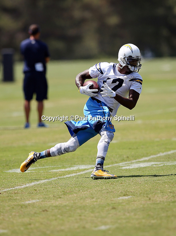 San Diego Chargers wide receiver and kick returner Jacoby Jones (12) runs with the ball after catching a pass during the San Diego Chargers Spring 2015 NFL minicamp practice on Wednesday, June 17, 2015 in San Diego. (©Paul Anthony Spinelli)