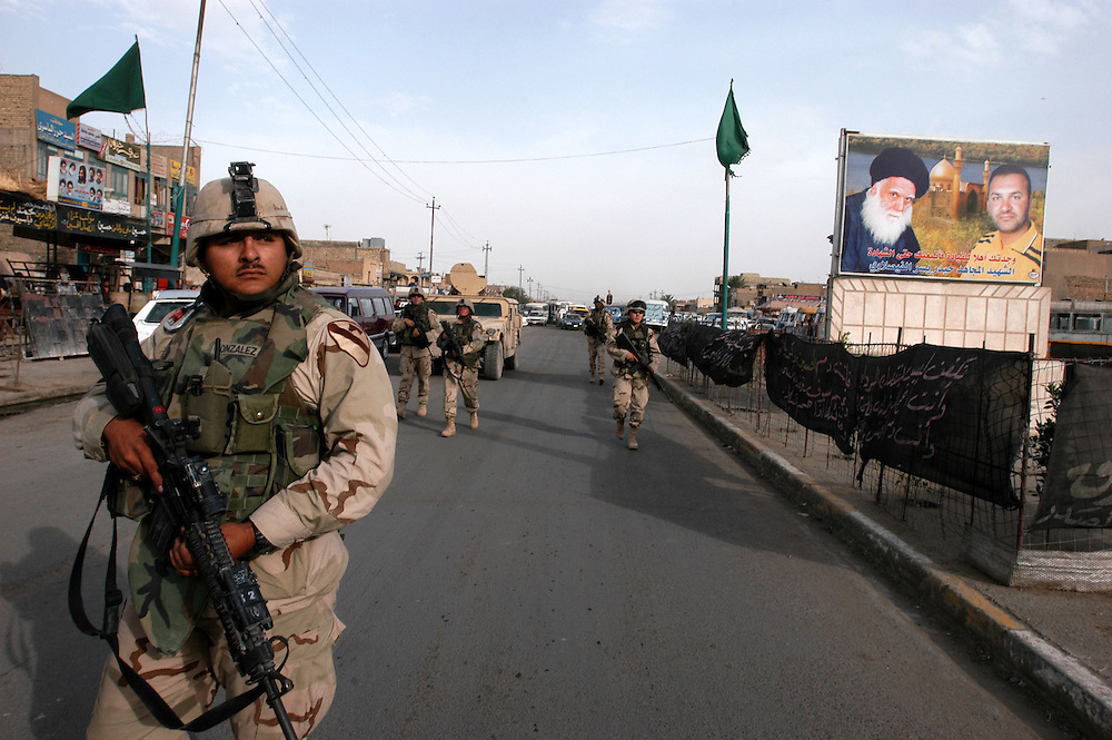 American army soldiers patrol the poor Shia neighborhood of Sadr City. The vast slum is a hotbed of support for radical Shiite cleric Moqtada al-Sadr. His militia, the Mahdi Army, attack Coalition forces on a daily basis.  .Baghdad, Iraq. 02/05/2004.Photo © J.B. Russell