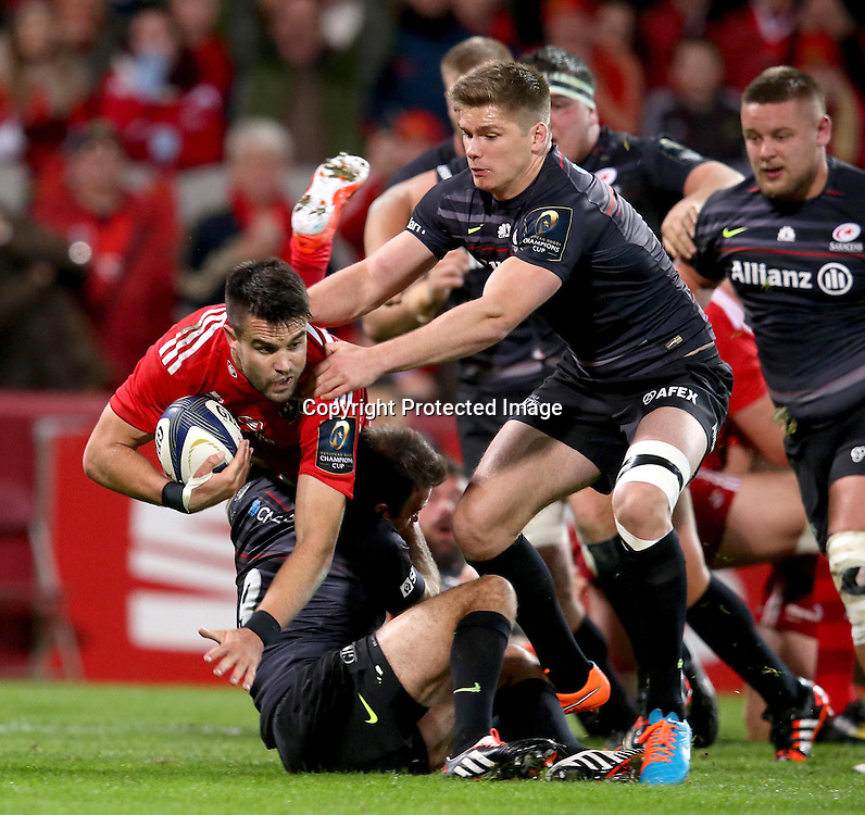 European Rugby Champions Cup Round 2, Thomond Park, Limerick 24/10/2014<br /> Munster vs Saracens<br /> Munster's Conor Murray tackled by Owen Farrell and Neil de Kock of Saracens<br /> Mandatory Credit &copy;INPHO/Dan Sheridan
