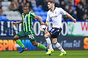 Bolton Wanderers defender Dorian Dervite (4) faces up to AFC Wimbledon forward Dominic Poleon (10)  during the EFL Sky Bet League 1 match between Bolton Wanderers and AFC Wimbledon at the Macron Stadium, Bolton, England on 4 March 2017. Photo by Simon Davies.