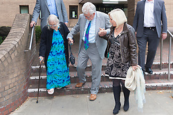London, June 20th 2014. Rolf Harris leaves Southwark Crown Court with his wife Alwen, left and daughter Bindi after a half day of waiting for the jury to return their verdicts on the 12 charges he faces of indecent assault against four girls aged 7 to 19.
