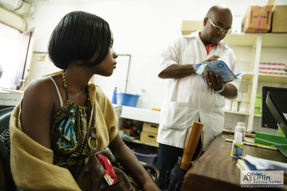 Marielle Gnabrayou Digbeto, 28, waits to get her prescription from the pharmacy at the Koumassi general hospital in Abidjan Cote d'Ivoire on Friday July 19, 2013. Marielle is pregnant with her first child and HIV positive, she is taking eMTCT medication.