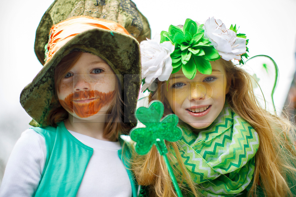 © Licensed to London News Pictures. 19/03/2017. London, UK. Children celebrate St Patrick's Day as a parade goes through the streets of central London on Sunday, 19 March 2017. Photo credit: Tolga Akmen/LNP