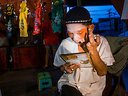 17 FEBRUARY 2016 - BANGKOK, THAILAND: A performer puts on his makeup before a Chinese opera performance in Bangkok. He's a member of a small troupe that travels from Chinese shrine to Chinese shrine performing for a few nights before going to another shrine. They spend about half the year touring in Thailand and the other half of the year touring in Malaysia. Members of the troupe are paid about 5,000 Thai Baht per month (about $140 US). Chinese opera was once very popular in Thailand, where it is called Ngiew. It is usually performed in the Teochew language. Millions of Chinese emigrated to Thailand (then Siam) in the 18th and 19th centuries and brought their culture with them. Recently the popularity of ngiew has faded as people turn to performances of opera on DVD or movies. There are still as many 30 Chinese opera troupes left in Bangkok and its environs. They are especially busy during Chinese New Year and Chinese holiday when they travel from Chinese temple to Chinese temple performing on stages they put up in streets near the temple, sometimes sleeping on hammocks they sling under their stage. Most of the Chinese operas from Bangkok travel to Malaysia for Ghost Month, leaving just a few to perform in Bangkok.     PHOTO BY JACK KURTZ
