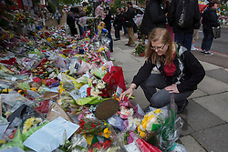© licensed to London News Pictures. London, UK 29/05/2013.Ingrid Loyau-Kennett, who confronted the  attackers in Woolwich terrorist attack, paying her respects at the scene where Drummer Lee Rigby was murdered by two men in Woolwich town centre. Photo credit: Tolga Akmen/LNP
