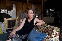 German-born, Beijing-based Marianne Friese, Malilian founder, designer and owner sitting on one of her creation.