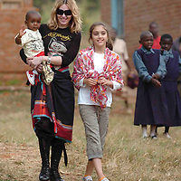 MALAWI, AFRICA:.Pop star Madonna at Mchinji with daughter Lourdes and adopted Malawian orphan baby David for day two of their visit to Malawi on 167April/07..PHOTOGRAPH BY TERRY KANE/ BARCROFT MEDIA LTD.+ 44 (0) 208 880 4977 www.barcroftmedia.com