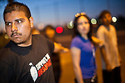 "Sept. 19 - PHOENIX, AZ: JOSHUA MONTANA drills behind US Sen. John McCain's office in Phoenix Sunday night. About 30 people met in front of US Sen. John McCain's office in Phoenix Sunday night to demonstrate in support of the DREAM Act, which is scheduled to be debated in the US Senate on Tuesday, Sept 21. The Development, Relief and Education for Alien Minors Act (The ""DREAM Act"") is a piece of proposed federal legislation in the United States that was introduced in the United States Senate, and the United States House of Representatives on March 26, 2009. This bill would provide certain illegal immigrant students who graduate from US high schools, who are of good moral character, arrived in the U.S. as minors, and have been in the country continuously for at least five years prior to the bill's enactment, the opportunity to earn conditional permanent residency. In the early part of this decade McCain supported legislation similar to the DREAM Act, but his position on immigration has hardened in the last two years and he no longer supports it. The protesters, mostly area students, marched and drilled to show their support for the US military and then held a candle light vigil.   Photo by Jack Kurtz"