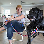 BOYDS, MD - SEP09: Jennifer Ellington, works with a service dog, at the Warrior Canine Connection in Boyds, Maryland. (Photo by Evelyn Hockstein/For The Washington Post)