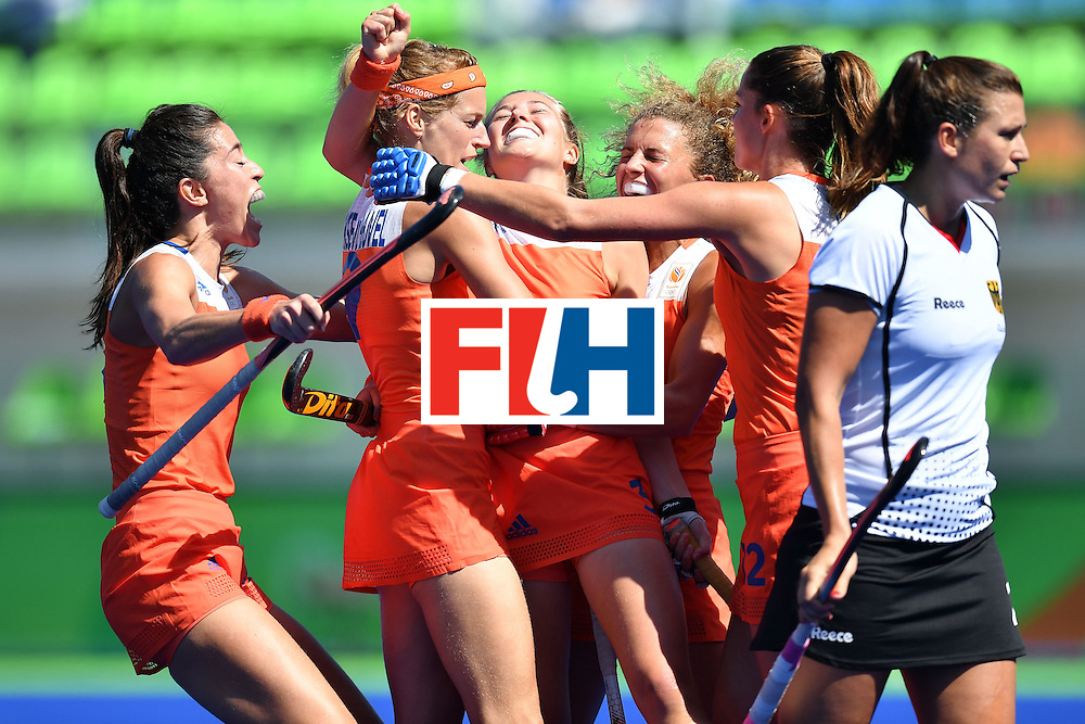 Netherlands' Xan De Waard (C) celebrates scoring with her team-mates during the women's field hockey Netherlands vs Germany match of the Rio 2016 Olympics Games at the Olympic Hockey Centre in Rio de Janeiro on August, 13 2016. / AFP / MANAN VATSYAYANA        (Photo credit should read MANAN VATSYAYANA/AFP/Getty Images)