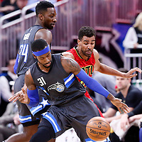 25 February 2017: Atlanta Hawks forward Thabo Sefolosha (25) defends on Orlando Magic forward Terrence Ross (31) next to Orlando Magic forward Jeff Green (34) during the Orlando Magic 105-86 victory over the Atlanta Hawks, at the Amway Center, Orlando, Florida, USA.