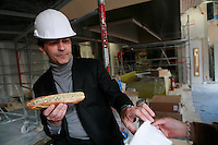"Yannick Alleno with a hotdog Tete de Veau in the construction space of his new restaurant ""Terroir Parisian,"" opening March 2012 -photograph by Owen Franken for the NY Times"