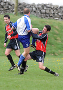 Eamon Cleary Kiltullagh Pioneers nails Johnny O Dea  Kinvara FC in Kiltullagh, Galway. Photo:Andrew Downes