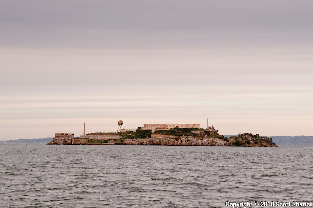 Alcatraz Island and prison from the bay at sunset.