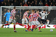 Derby County forward Tom Lawrence runs at goal as Stoke City players challenge during the EFL Sky Bet Championship match between Derby County and Stoke City at the Pride Park, Derby, England on 12 March 2019.