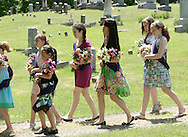 Hamptonburgh, NY - Young girls carry flowers to place on veterans' graves during Memorial Day ceremonies at Hamptonburgh Cemetery on May 25, 2009. This was the 142nd year flowers have been placed at veterans' graves on Memorial Day, which was formerly known as Decoration Day.