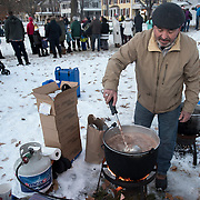 "BRUNSWICK, Maine  11/24/18 -- Mark Rockwood of Brunswick, stirs the hot chocolate at the Brunswick's tree lighting event on Saturday. He said, ""No weak cocoa here,"" as added three cans to the batch. Hannaford supermarket donated the cocoa. <br /> Trevor Geiger, of Brunswick Downtown Association, said that the organization expected over 1500 guests at the event and that they counted participation by the number of cups of cocoa they passed out. He added that there were more than 20 volunteers helping out with the event and over 1500 cookies were on the table. Most were homemade, by volunteers. Photo by Roger S. Duncan."