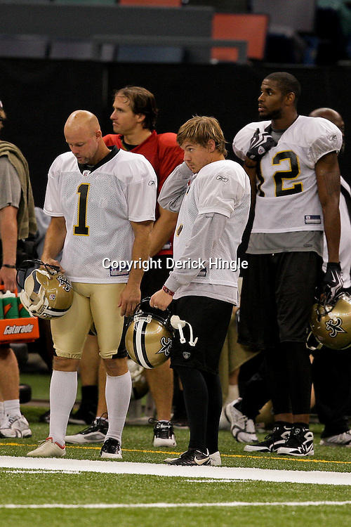 24 August 2009: Saints kickers, John Carney (1) and Garrett Hartley (right) on the sideline during New Orleans Saints training camp practice at the Louisiana Superdome in New Orleans, Louisiana.