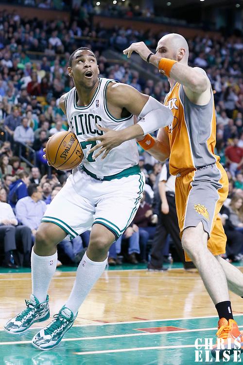 09 January 2013: Boston Celtics power forward Jared Sullinger (7) drives past Phoenix Suns center Marcin Gortat (4) during the Boston Celtics 87-79 victory over the Phoenix Suns at the TD Garden, Boston, Massachusetts, USA.