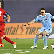 NEW YORK, NEW YORK - November 06:  Frank Lampard #8 of New York City FC is watched by Michael Bradley #4 of Toronto FC during the NYCFC Vs Toronto FC MLS playoff game at Yankee Stadium on November 06, 2016 in New York City. (Photo by Tim Clayton/Corbis via Getty Images)