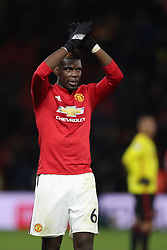 Manchester United's Paul Pogba applauds supporters after the final whistle during the Premier League match at Vicarage Road, Watford.