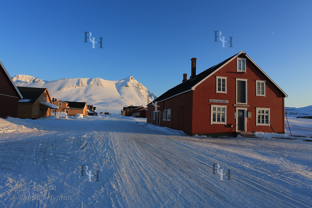 Town museum, once a general store, stands at entrance to international science village of Ny-Alesund amid April snows on Spitsbergen island in Kongsfjorden; Svalbard, Norway.