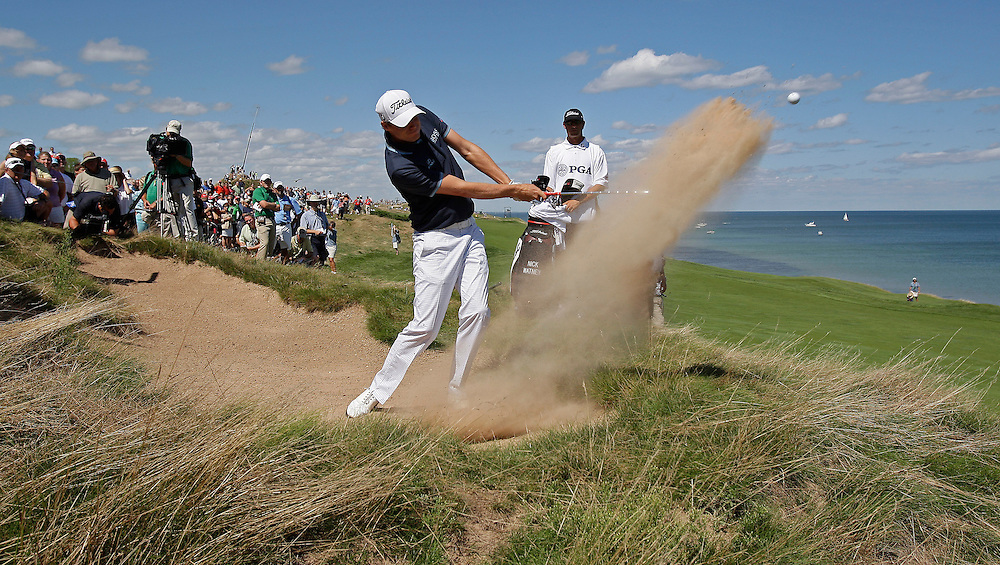 pga16, spt, lynn, 13.-Nick Watney blasts out of the sand onto the 4th green at Whistling Straits on the final day of the PGA Championship Sunday August 15, 2010.  Photo by Tom Lynn/TLYNN@JOURNALSENTINEL.COM