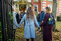 © Licensed to London News Pictures. 22/12/2016. London, UK. 14 of the 15 Heathrow Airport protestors hold hands  outside Ealing Magistrates Court in London, where they are charged with Wilful Obstruction of the Highway after blocking an access road to Heathrow on November 18, 2016. Photo credit: Ben Cawthra/LNP