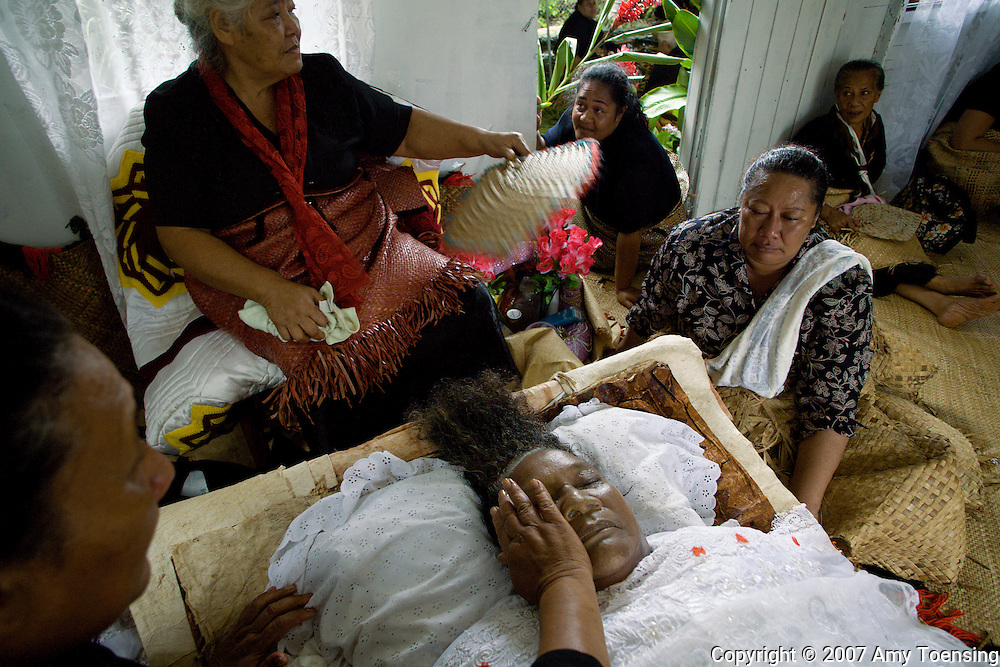 HA'APAI, TONGA - APRIL 04:  Tongan women mourn at the funeral of Kalisi Lolohea Paonga on April 4, 2007 in the village of Pangai, on the island of Ha'apai, Tonga. Tonga is one of the last surviving monarchies in the Pacific islands, however there has been a recent push towards democratic reform, challenging the people of Tonga to maintain their cultural heritage while conforming to modern day capitalism. (Photo by Amy Toensing/ Reportage by Getty Images) _________________________________<br />
