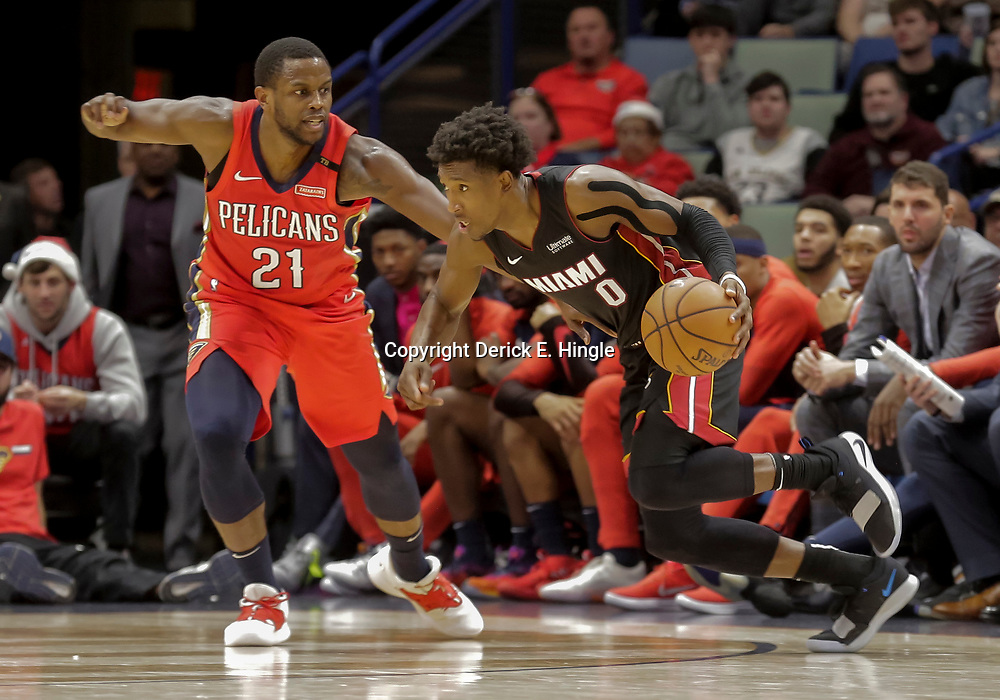 Dec 16, 2018; New Orleans, LA, USA; Miami Heat guard Josh Richardson (0) drives past New Orleans Pelicans forward Darius Miller (21) during the second half at the Smoothie King Center. Mandatory Credit: Derick E. Hingle-USA TODAY Sports