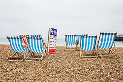 © Licensed to London News Pictures. 12/05/2018. Brighton, UK. Deckchairs and bar terraces stand unused and empty on the beach in Brighton and Hove as colder and grey weather is hitting the seaside resort. Photo credit: Hugo Michiels/LNP