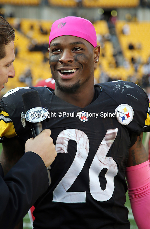 Pittsburgh Steelers running back Le'Veon Bell (26) smiles as he does a postgame television interview after the 2015 NFL week 6 regular season football game against the Arizona Cardinals on Sunday, Oct. 18, 2015 in Pittsburgh. The Steelers won the game 25-13. (©Paul Anthony Spinelli)
